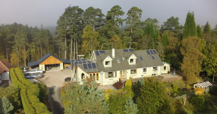 A view of Woodside B&B from the air with the natural forest behind our home